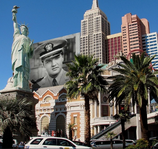 Elvis with Statue of Liberty in city